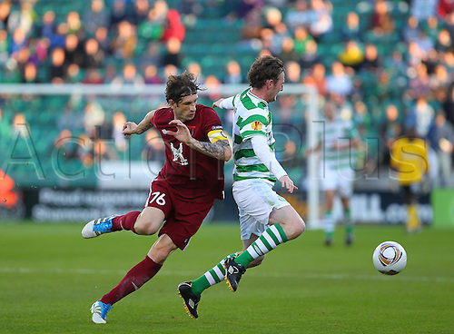 15.09.2011 Europa League football from the Tallaght Stadium in Dublin. Shamrock Rovers V Rubin Kazan. Roman Sharonov (Captain Rubin Kazan) challenges Gary Twigg (Shamrock Rovers) from behind, giving away a free-kick.