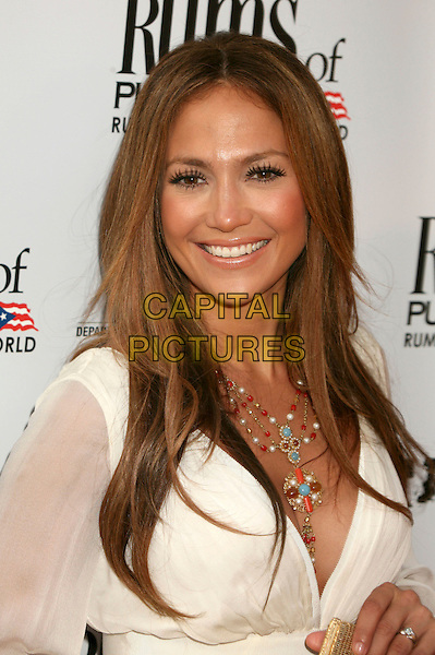 """JENNIFER LOPEZ.The Picturehouse L.A. Premiere of """"El Cantante"""" held at The DGA in West Hollywood, California, USA..July 31st 2007.headshot portrait turquoise gold pearl coral bead cross necklace false eyelashes .CAP/ADM/BP.©Byron Purvis/AdMedia/Capital Pictures"""