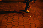 An Egyptian man stands near a blood stain following disperse an anti-Mubarak protest Egyptian riot police at Abdel Moneim Riad, a main transportation hub for taxis and buses, after hearing the verdict of former Egyptian president Hosni Mubarak, in Cairo, Egypt, 29 November 2014. An Egyptian court on 29 November dismissed murder charges against former president Mubarak, a verdict that angered activists who had mobilized the uprising that ended his rule in 2011. The charges were related to the killing of hundreds of protesters during the uprising, part of the so-called Arab Spring revolts. The Cairo Criminal Court also acquitted Mubarak's interior minister, Habib al-Adly, as well as several former security chiefs of the same charges. Photo by Amr Sayed