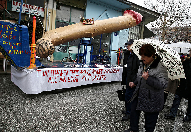 """Pictured: A penis-shaped float with a slogan reading """"I shagged him but it didn't fulfil my needs, do you thing he is a mother-fucker"""" in Tirnavos, central Greece. 19 February 2018<br /> Re: Bourani (or Burani) the infamous annual carnival which dates to 1898 which takes place on the day of (Clean Monday), the first days of Lent in Tirnavos, central Greece, in which men hold phallus shaped objects as scepters in their hands."""