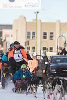Mats Pettersson and team leave the ceremonial start line with an Iditarider at 4th Avenue and D street in downtown Anchorage, Alaska on Saturday March 2nd during the 2019 Iditarod race. Photo by Brendan Smith/SchultzPhoto.com