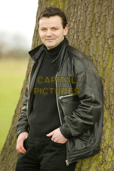 WAYNE FORRESTER.February 14th, 2005.Ref: FEE.half length black leather jacket poloceck turtleneck.www.capitalpictures.com.sales@capitalpictures.com.© Capital Pictures.