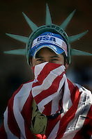"LOS ANGELES,CA - OCTOBER 10,2009:  Carmen Fermin, originally from Mexico, now a local resident dons the colors of his new home during the ""Full Rights for Immigrants March"" and rally along Broadway in downtown Los Angeles, October 10, 2009..( Photo: Spencer Weiner/Los Angeles Times.com )"