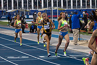 Mizzou junior Karissa Schweizer crosses the finish lilne to take 8th in the professional women's 1500-meters in the 15 runner race at the Drake Relays, Friday, April 28, in Des Moines, Iowa. Schweizer finished in 4:18.16 on a cold night under the lights.