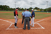 Edgewood Eagles head coach Al Brisack (left) during the lineup exchange with Bethel Wildcats head coach Brian Raabe (right) before the first game of a double header on March 15, 2019 at Terry Park in Fort Myers, Florida.  Bethel defeated Edgewood 6-0.  (Mike Janes/Four Seam Images)