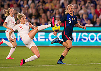 5th March 2020, Orlando, Florida, USA;  England defender Steph Houghton (5) stops the cross watched by the United States midfielder Lindsey Horan (9) during the Women's SheBelieves Cup soccer match between the USA and England on March 5, 2020 at Exploria Stadium in Orlando, FL.