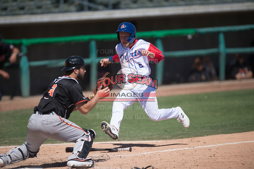 Stockton Ports second baseman Nick Allen (2) prepares to slide into home plate in front of Joey Bart (9) during a California League game against the San Jose Giants on April 9, 2019 in Stockton, California. San Jose defeated Stockton 4-3. (Zachary Lucy/Four Seam Images)