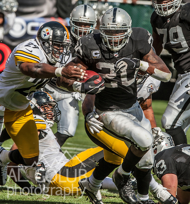 Oakland Raiders running back Darren McFadden (20) gets away from Pittsburgh Steelers free safety Ryan Mundy (29) on Sunday, September 23, 2012, in Oakland, California. The Raiders defeated the Steelers 34-31.  .