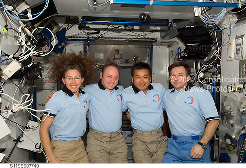 In Earth Orbit - March 24, 2009 -- NASA astronauts Sandra Magnus, STS-119 mission specialist; and Michael Fincke (second left), Expedition 18 commander; along with Japan Aerospace Exploration Agency astronaut (JAXA) Koichi Wakata and cosmonaut Yury Lonchakov, both Expedition 18 flight engineers, pose for a photo following a joint news conference in the Harmony node of the International Space Station while Space Shuttle Discovery remains docked with the station. Magnus, who joined the station's Expedition 18 crew in November 2008, is being replaced by Wakata, who arrived at the station with the STS-119 crew..Credit: NASA via CNP