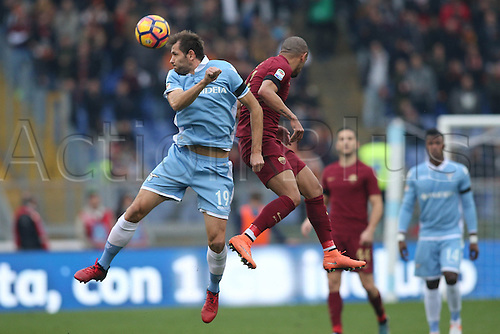 04.12.2016. Stadio Olimpico, Rome, Italy. Serie A Football. Lazio versus Roma. Lulic and Peres in heading action during the match.