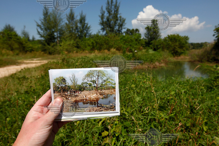Khao Lak, north of Phuket. The area was severley hit by the Tsunami that struck Asia 26/12/2004.The area has since been rebuilt, and tourists have returned.  Photographer holding a picture taken at the same spot five years earlier. .©Fredrik Naumann/Felix Features.