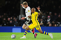 Andre Ayew of Swansea City under pressure from Tim Ream of Fulham during the Sky Bet Championship match between Fulham and Swansea Citry at Craven Cottage in London, England, UK. Wednesday February 26, 2020.