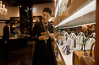 Mrs. Sung-Joo Kim looks at a display of MCM Signature Cognac Visetos items in the new MCM Shanghai flagship store on the Bund in Shanghai, China, on Tues., Jan. 26, 2010.  The MCM Signature Cognac Visetos line prominently features the MCM logo.  A glamorous fashion line in the 1980s, South Korean billionaire Sung-Joo Kim has purchased the MCM luxury brand in hopes of reinvigorating the brand.  Now Sung-Joo Kim is trying to replicate the brand's Asian success in Western markets, part of a greater shift of Asian luxury brands being exported to American and European high streets.  The MCM Shanghai flagship store, located on the world-famous Bund in Shanghai, was opened on Tues., Jan. 26, 2010...CREDIT: M. Scott Brauer for the Wall Street Journal