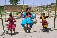 AFGHANISTAN, 06.2008, Kabul. Maedchen schaukeln in der fuer Frauen reservierten Zone Bogha.   Girls playing on the swings in the women-only zone of Bogha.<br /> © Marzena Hmielewicz/EST&OST
