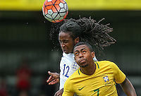 Tafari Moore (FC Utrecht, loan from Arsenal) of England & Malcom of Brazil go up for the ball during the International match between England U20 and Brazil U20 at the Aggborough Stadium, Kidderminster, England on 4 September 2016. Photo by Andy Rowland / PRiME Media Images.