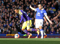 Pictured L-R: Jonathan de Guzman of Swansea is fouled by Leon Osman of Everton. Sunday 16 February 2014<br /> Re: FA Cup, Everton v Swansea City FC at Goodison Park, Liverpool, UK.