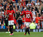 Wayne Rooney of Manchester United hands over the captains armband to Axel Tuanzebe of Manchester United during the English Premier League match at the Old Trafford Stadium, Manchester. Picture date: May 21st 2017. Pic credit should read: Simon Bellis/Sportimage