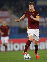 Calcio, Champions League: Gruppo E - Roma vs Bate Borisov. Roma, stadio Olimpico, 9 dicembre 2015.<br /> Roma's Edin Dzeko in action during the Champions League Group E football match between Roma and Bate Borisov at Rome's Olympic stadium, 9 December 2015.<br /> UPDATE IMAGES PRESS/Riccardo De Luca