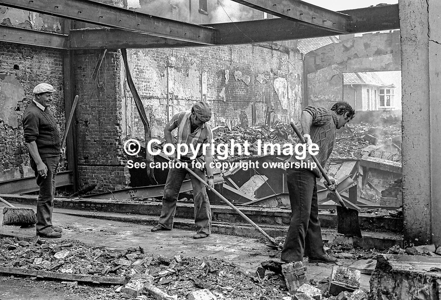 Main Street, Portrush, Co Antrim, N Ireland - mopping up after an overnight bombing blitz by the Provisional IRA. The IRA's 8 bombs were at the height of the popular resort's holiday season. 4th August 1976. 197608040336b<br /> <br /> Copyright Image from Victor Patterson, 54 Dorchester Park, Belfast, UK, BT9 6RJ<br /> <br /> Tel: +44 28 9066 1296<br /> Mob: +44 7802 353836<br /> Voicemail +44 20 8816 7153<br /> Email: victorpatterson@me.com<br /> <br /> <br /> IMPORTANT: If you wish to use this image or any other of my images please go to www.victorpatterson.com and click on the Terms &amp; Conditions. Then contact me by email or phone with the reference number(s) of the image(s) concerned.