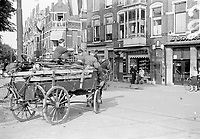Photo from the NIOD's Huizinga collection. After their surrender, German soldiers leave with horse carts full of stolen items, including bicycles.