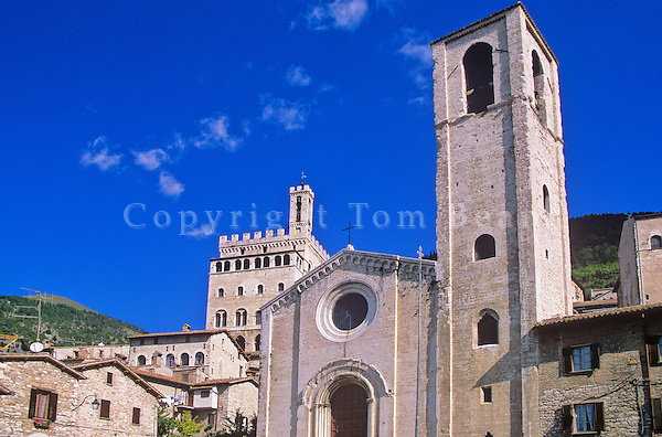 Gubbio, an ancient Umbrian hill town with facade of San Giovanni Battista and the Palazzo Dei Consoli on hill in back at Gubbio, Umbria, Italy, AGPix_0510...