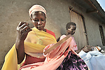 Esta Unclo (left) and Monica Kaku participate in a tailoring class provided by United Methodist Women in Yei, Southern Sudan. NOTE: In July 2011, Southern Sudan became the independent country of South Sudan