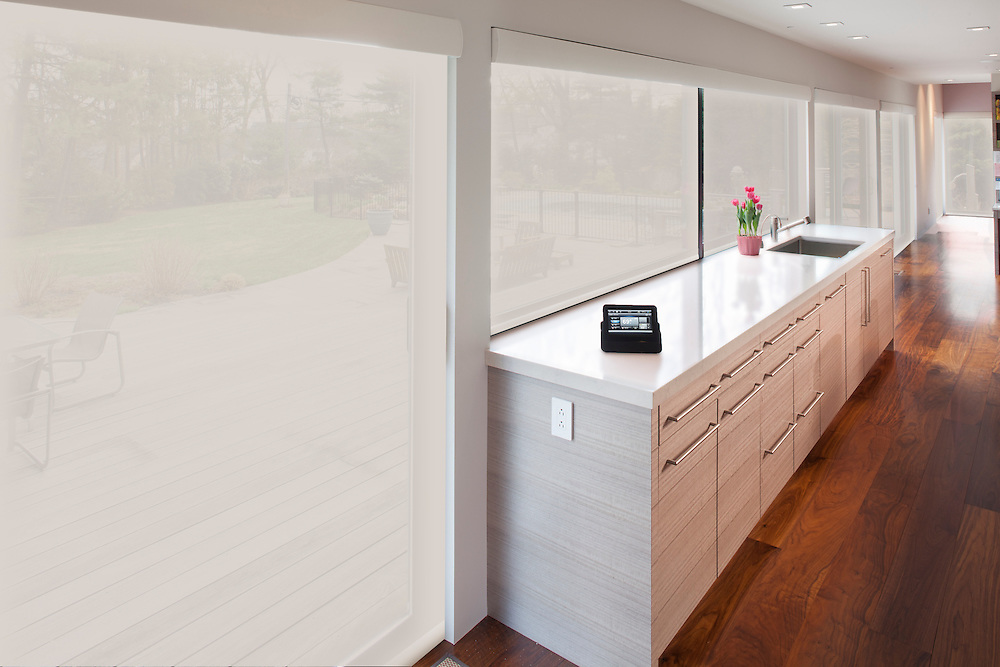 This home's large window wall has custom Lutron Battery-operated roller shades to maintain the right amount of sun and privacy.