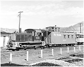 Diesel switcher #50 and caboose #0587.  Short pieces of assembled track in foreground.  Excursion car in background.<br /> D&amp;RGW  Durango, CO