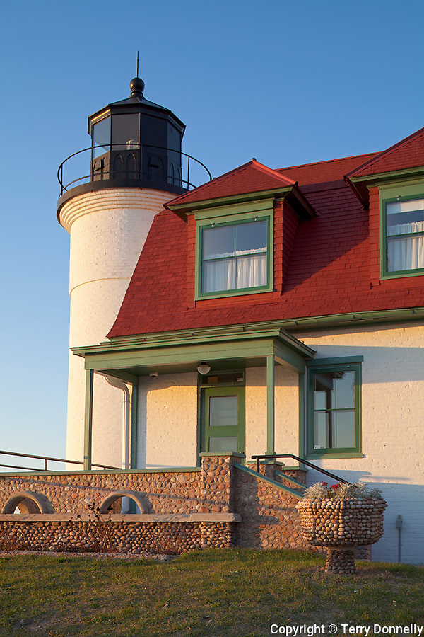 Benzie County, Michigan<br /> Evening light on the Point Betsie Lighthouse (1858) with light keeper's house with  cobblestone railing, Lake Michigan