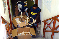 Rome 3 December 2007.Italien policemen of the Forest Guard employee to control of  international trade of plant's  and animals species protected  with agents of the Financial police seized  material from protected species in a  somali's store of district Equilino  .The mouth of a shark