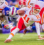 9 November 2014: Kansas City Chiefs quarterback Alex Smith scrambles in the backfield during the fourth quarter against the Buffalo Bills at Ralph Wilson Stadium in Orchard Park, NY. The Chiefs rallied with two fourth quarter touchdowns to defeat the Bills 17-13. Mandatory Credit: Ed Wolfstein Photo *** RAW (NEF) Image File Available ***