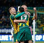 Nederland, Den Haag, 21 februari 2014<br /> Eredivisie<br /> Seizoen 2013-2014<br /> ADO Den Haag-Go Ahead Eagles <br /> Danny Bakker van ADO Den Haag viert zijn doelpunt, de 2-0, met Mike van Duinen (l.) en Tom Beugelsdijk (r.) van ADO Den Haag.