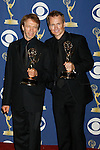 LOS ANGELES, CA. - September 20: Producers of 'The Amazing Race' Jerry Bruckheimer and Phil Keoghan  pose in the press room at the 61st Primetime Emmy Awards held at the Nokia Theatre on September 20, 2009 in Los Angeles, California.