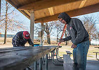 NWA Democrat-Gazette/ANTHONY REYES @NWATONYR<br /> Brent Rhoades (right), crew supervisor at Tyson Sports Complex, and Francisco Cortez with Springdale Parks and Recreations department, pull out staples from picnic tables Wednesday, Feb. 15, 2017 in a pavilion at the Tyson Sports Complex in Springdale. The crew is getting ready to paint all the tables. A Boy Scout Troop will soon reroof the pavilion.