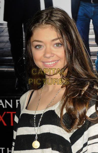"""SARAH HYLAND .arriving at the premiere of """"Extraordinary Measures"""" at Grauman's Chinese Theatre in Hollywood, California, USA,   January 19th, 2010..arrivals portrait headshot black and white striped gold necklace smiling .CAP/ROT.©Lee Roth/Capital Pictures"""