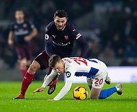 Brighton & Hove Albion's Solly March (right) is brought down as he come under pressure from  Arsenal's Sead Kolasinac (left) <br /> <br /> Photographer David Horton/CameraSport<br /> <br /> The Premier League - Brighton and Hove Albion v Arsenal - Wednesday 26th December 2018 - The Amex Stadium - Brighton<br /> <br /> World Copyright © 2018 CameraSport. All rights reserved. 43 Linden Ave. Countesthorpe. Leicester. England. LE8 5PG - Tel: +44 (0) 116 277 4147 - admin@camerasport.com - www.camerasport.com