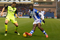 Frank Nouble of Colchester United drags the ball back to try and get inside Pierce Sweeney of Exeter City during Colchester United vs Exeter City, Sky Bet EFL League 2 Football at the JobServe Community Stadium on 24th November 2018