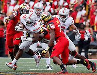 Ohio State Buckeyes running back Ezekiel Elliott (15) works to cut through the Maryland defense in the third quarter of their game at Byrd Stadium in College Park, Maryland on October 4, 2014. (Columbus Dispatch photo by Brooke LaValley)