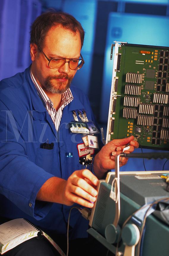 A technician tests computer circuits