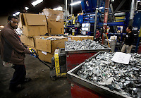 12/4/2008 4:01:20 PM -- Seattle, WA.Employee Tyrone Wiggins, 33, of Kent, Wash., takes a bin of scrap, pieces of which are no larger than two-inches square, to a scale at Total Reclaim Inc., Environmental Services in Seattle Thursday Dec. 4, 2008.