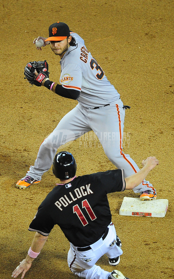 May 13, 2012; Phoenix, AZ, USA; San Francisco Giants shortstop Brandon Crawford throws to first base to complete the double play after forcing out Arizona Diamondbacks base runner (11) A.J. Pollock in the seventh inning at Chase Field. Mandatory Credit: Mark J. Rebilas-