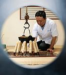 Hiroshi Ishikawa, who runs Hokushu Kurabu, makes kiritanpo nabe hot pot at his restaurant Odate, Akita Prefecture Japan. The restaurant has served the dish for well over a century. Photographer: Rob Gilhooly