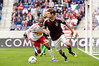 Drew Moor (3) of the Colorado Rapids looks to clear under pressure from Dane Richards (19) of the New York Red Bulls. The New York Red Bulls defeated the Colorado Rapids 4-1 during a Major League Soccer (MLS) match at Red Bull Arena in Harrison, NJ, on March 25, 2012.