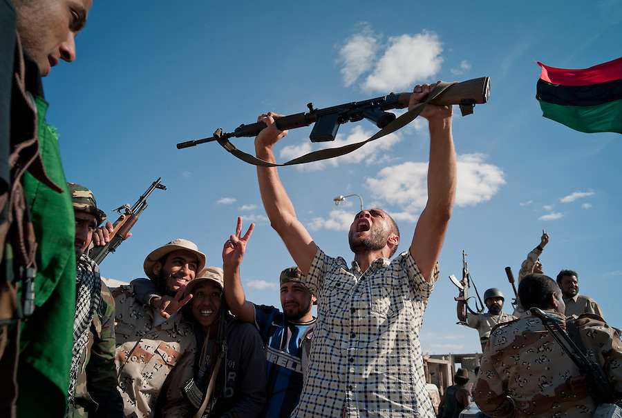 Anti-Gaddafi fighters celebrate the declared victory in Sirte, Libya.