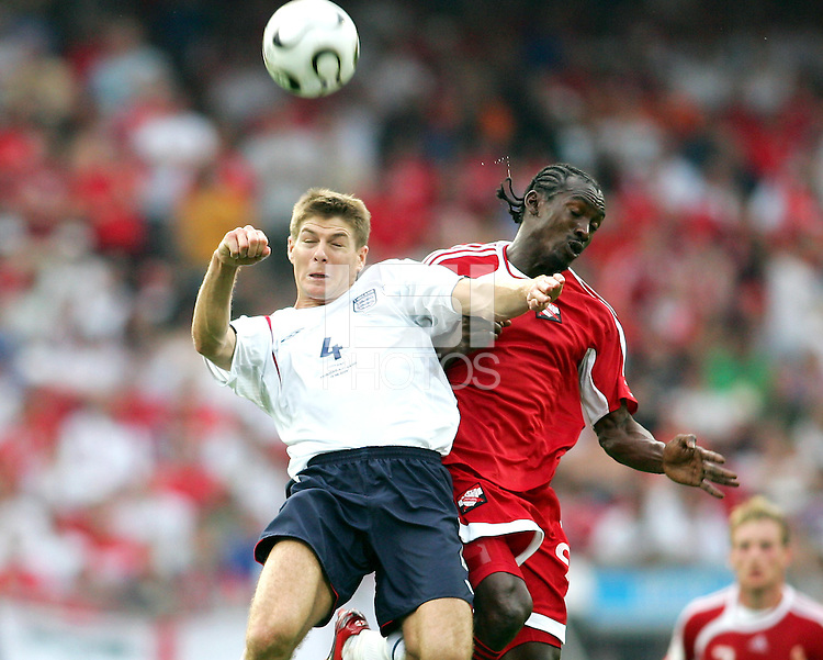 Steven Gerrard of England and Aurtis Whitley of Trinidad clash over a high ball. England defeated Trinidad & Tobago 2-0 in their FIFA World Cup group B match at Franken-Stadion, Nuremberg, Germany, June 15 2006.