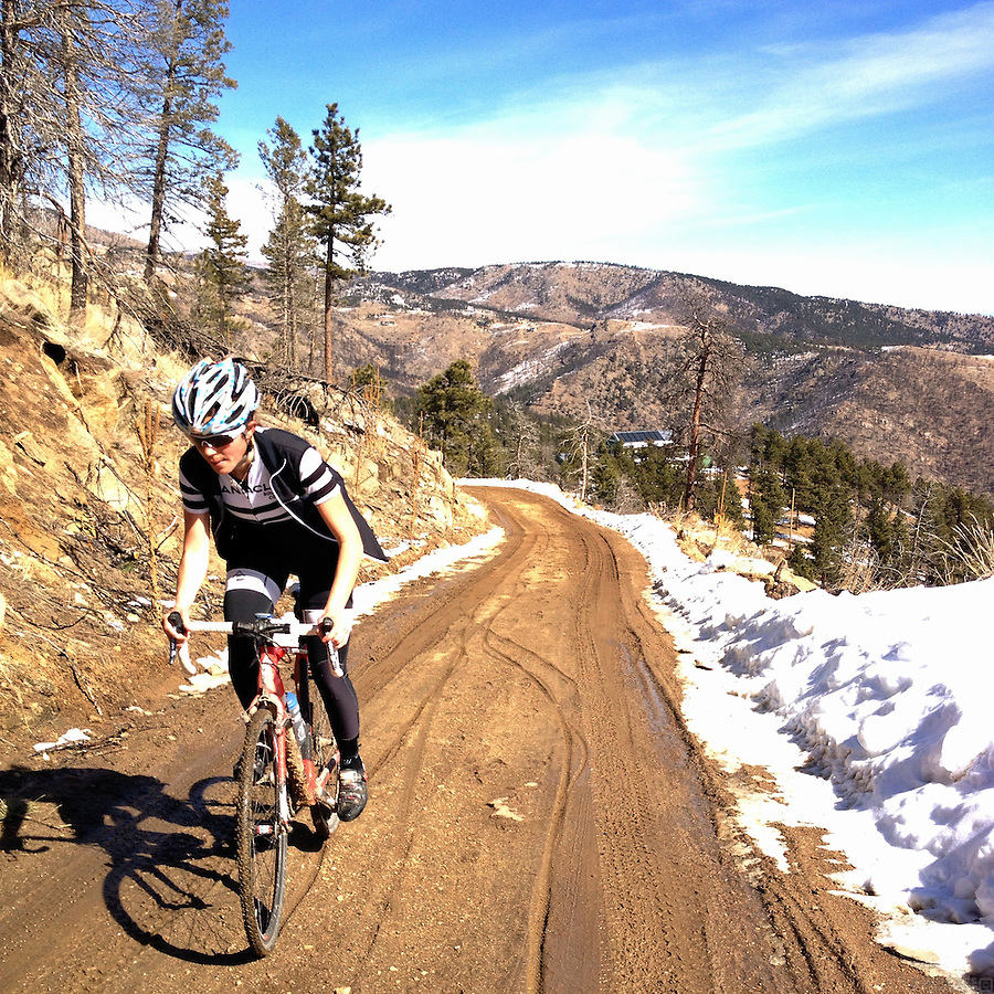 Riding through the mud on Logan Mill Road, in the foothills above Boulder, Colorado.