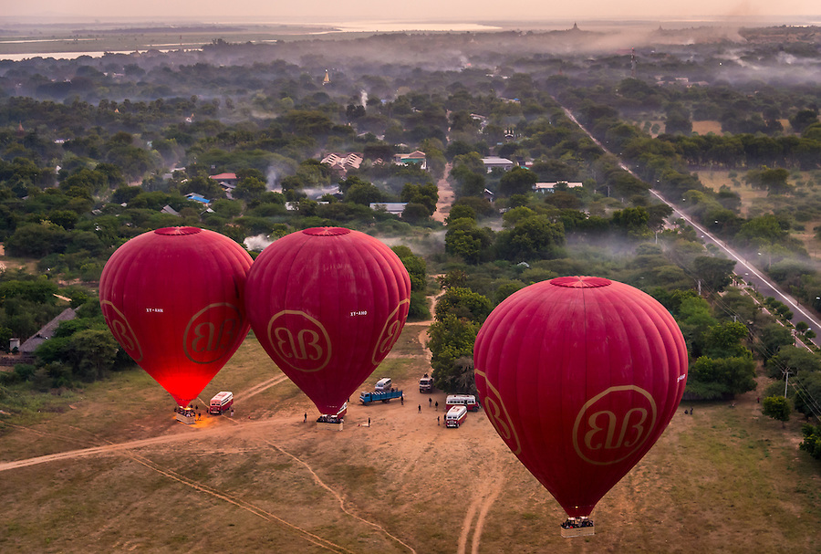 BAGAN, MYANMAR - CIRCA DECEMBER 2013: Hot air balloons ready to fly over the plains of Bagan early morning.
