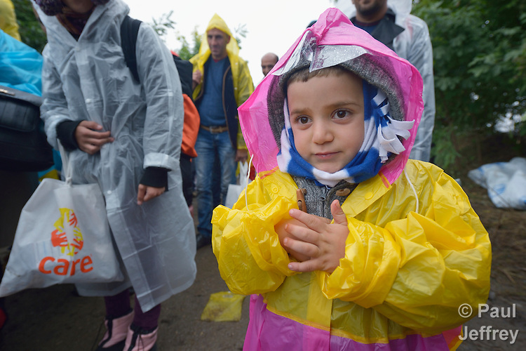 A child refugee approaches the border into Croatia near the Serbian village of Berkasovo. Hundreds of thousands of refugees and migrants from Syria, Iraq and other countries--including many children--have flowed through Serbia in 2015, on their way to western Europe.