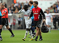 Pictured: Nathan Dyer walking off pitch with physiotherapist. Saturday 17 September 2011<br /> Re: Premiership football Swansea City FC v West Bromwich Albion at the Liberty Stadium, south Wales.