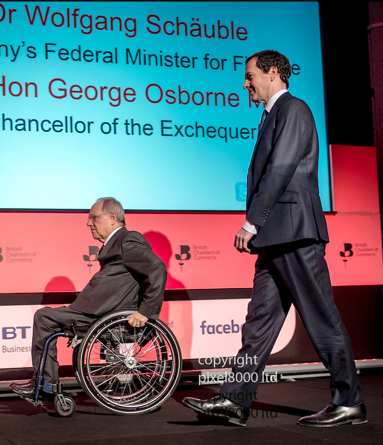 Pix shows: British Chambers of Commerce<br /> QEII Centre London.<br /> <br /> George Osborne and Dr Woflgang Schauble  - German Finance Minister - smile and joke through questions.<br /> <br /> Schauble said Germany 'would cry' if Britain left Europe.<br /> <br /> <br /> <br /> <br /> Pic by Gavin Rodgers/Pixel 8000 Ltd
